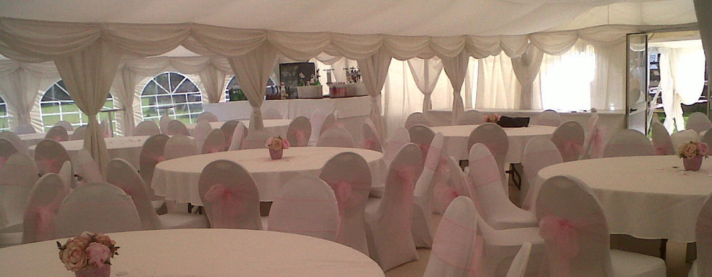 A wedding marquee interior, full lined marquee chairs and tables