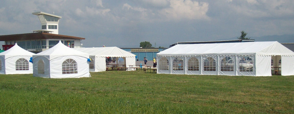 multiple marquees for sale at an airshow